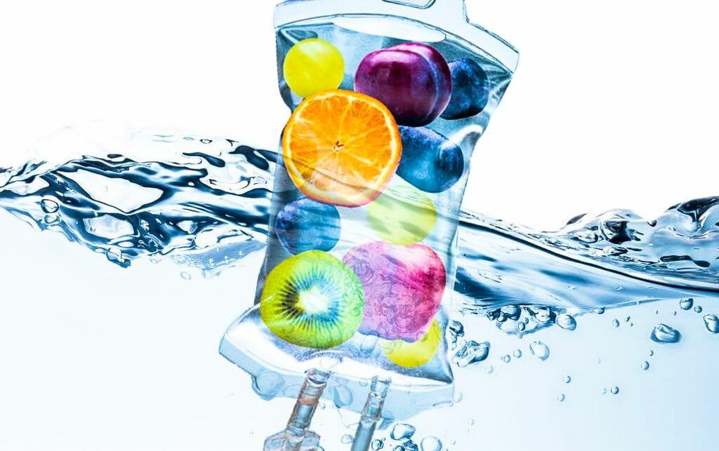 iv bag filled with various fruits and floating in water to demonstrate health and hydration benefits of IV Therapy, Injection Therapy and Micronutrient Testing